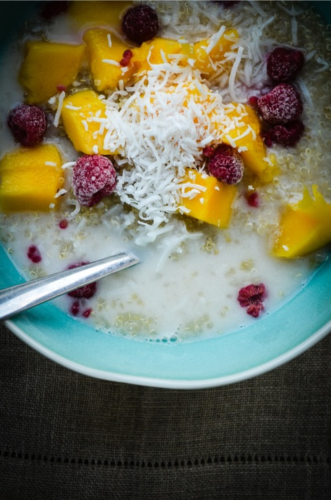 Quinoa Breakfast Bowl with Banana, Mango, Coconut and Raspberries